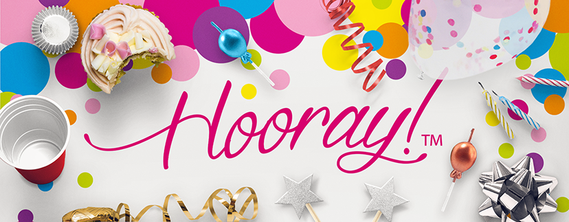 Hooray Party with candles and ribbons, cupcake holders and party supplies for retail