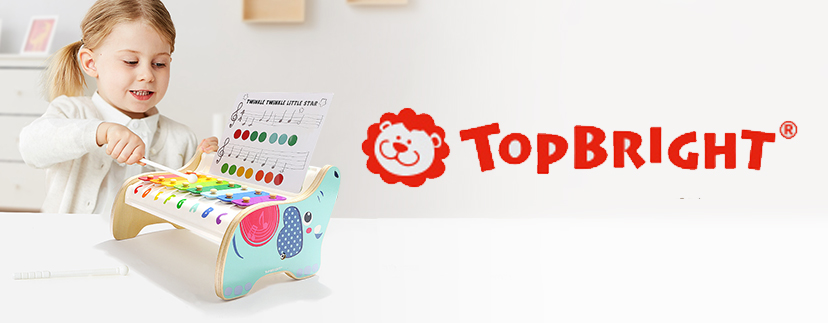 Girl playing xylophone with Topbright logo